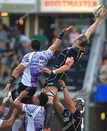 Scotland's Alastair Kellock, top right, wins the line out against Samoa's Daniel Leo, top left, during their Rugby Test match at Kings Park Stadium in Durban, South Africa