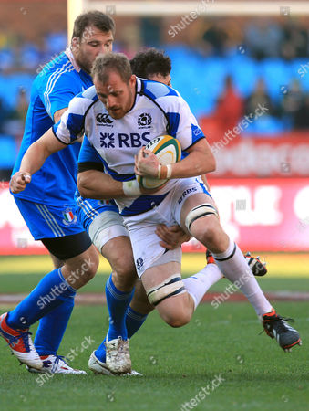 Alastair Kellock, Alessandro Zanni Scotland's Alastair Kellock, front, is tackled by Italy's Alessandro Zanni, back, during their Rugby Test at match at Loftus Versfeld Stadium in Pretoria, South Africa