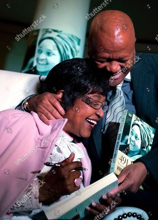 """Winnie Madikizela-Mandela Winnie Madikizela-Mandela, left, reacts with Justice Minister Jeff Radebe, right, during her book launch at the Constitution Hill in Johannesburg, South Africa, . Mandela, an Apartheid-era struggle stalwart, was joined by family and friends at a former women's prison in Johannesburg's Constitutional Hill to launch """"491 days"""" - an account of her arrest and imprisonment in solitary confinement"""
