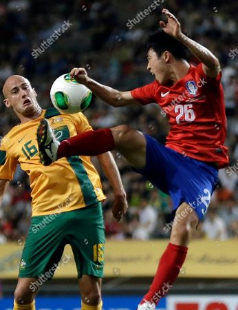 South Korea's Lee Seung-gi, right, fights for the ball against Australia's Ruben A. Zadkovic during their East Asian Cup soccer match at Seoul World Cup stadium in Seoul, South Korea. The second round of the Asian Champions League takes on extra emphasis for some World Cup hopefuls this week, with South Korea's Hong Myong-bo among the national team coaches carefully watching the continental club competition before announcing his squad for Brazil 2014