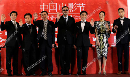 Jeong Tae-sung, Kim Eui-suk, Wong Kar-wai, Tony Leung, Zhang Ziyi, Chun Jung-myung Hong Kong director Wong Kar-wai, center, Hong Kong actor Tony Leung, third right, Chinese actress Zhang Ziyi, second right, and South Korean actor Chun Jung-myung, far right, pose during the press conference for the Chinese Film Festival in Seoul, . The 5th Chinese Film Festival opened in Seoul on Sunday for a 5-day celebration of Chinese films to boost bilateral cooperations of the movies and culture. At left is head of CJ E&M Pictures Jeong Tae-sung, and Chairman of Korean Film Council Kim Eui-suk, second left