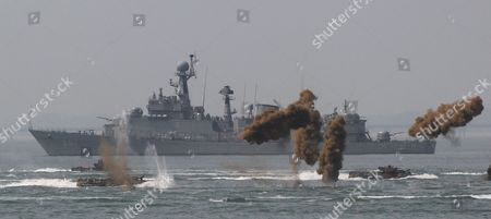 South Korean marine landing craft make their way to the shore through smoke screens during the 63rd Incheon Landing Operations Commemoration ceremony, in waters off Incheon, South Korea. Incheon is the coastal city where United Nations Forces led by U.S. General Douglas MacArthur landed in September 1950 just months after North Korea invaded the South