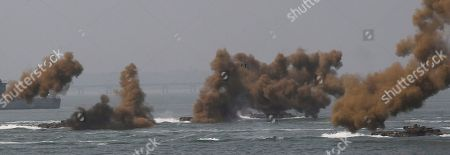 South Korean marine landing craft approach their way to shores through smoke screen during the 63nd Incheon Landing Operations Commemoration ceremony, in waters off Incheon, South Korea. Incheon is the coastal city where United Nations Forces led by U.S. General Douglas MacArthur landed in September, 1950 just months after North Korea invaded the South