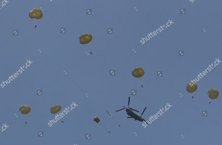 South Korean Special Forces soldiers parachute down from a helicopter during the 63nd Incheon Landing Operations Commemoration ceremony, in waters off Incheon, South Korea. Incheon is the coastal city where United Nations Forces led by U.S. General Douglas MacArthur landed in September, 1950 just months after North Korea invaded the South