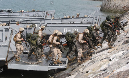 U.S. soldiers, khaki uniforms, and South Korean Marines participate in the 63nd Incheon Landing Operations Commemoration ceremony, in the waters of Incheon, South Korea. Incheon is the coastal city where United Nations Forces led by U.S. General Douglas MacArthur landed in September, 1950 just months after North Korea invaded the South
