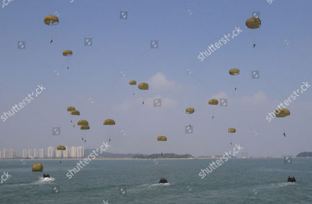South Korean Special Forces soldiers parachute into the water during the 63rd Incheon Landing Operations Commemoration ceremony, in waters off Incheon, South Korea. Incheon is the coastal city where United Nations Forces led by U.S. General Douglas MacArthur landed in September 1950 just months after North Korea invaded the South