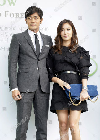 Stock Photo of Jang Dong-gun, Ko So-young South Korean actor Jang Dong-gun, left, and his wife and actress Ko So-young pose for the media upon their arrival for South Korean actor Lee Byung-hun and his bride and actress Rhee Min-jung's wedding ceremony in Seoul, South Korea