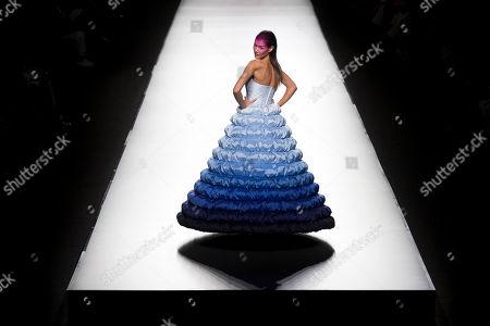Sheila Marquez displays a Spring/Summer design by Agatha Ruiz de la Prada during Madrid's Fashion Week, in Madrid, Spain