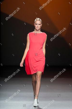 Stephanie Rad Stephanie Rad displays a Spring/Summer design by Amaya Arzuaga during Madrid's Fashion Week, in Madrid, Spain
