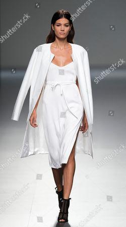 Sheila Marquez Sheila Marquez displays a Spring/Summer design by Angel Schlesser during Madrid's Fashion Week, in Madrid, Spain