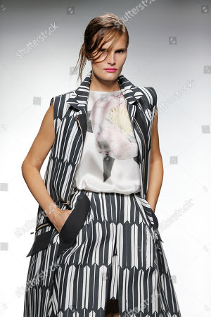 Model Alla Kostromichova displays a Spring/Summer design by Moises Nieto during Madrid's Fashion Week, in Madrid, Spain