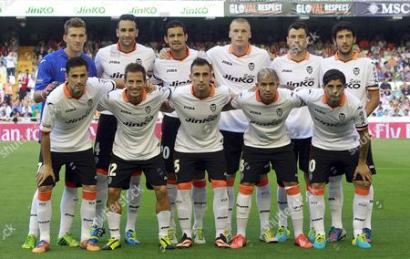 Vicente Guaita, Jeremy Mathieu, Adil Rami, Jose Luis Gaya, Dani Parejo, Jonas, Joao Pereira, Jonathan Viera, Sofiane Feghouli, Ever Banega Valencia players line up for a group photograph before their Guinness International Champions Cup soccer match against Milan at the Mestalla stadium in Valencia, Spain, . Back row from left to right, goalkeeper Vicente Guaita, Adil Rami from France, Ricardo Costa from Portugal, Jeremy Mathieu from France, Jose Luis Gaya, Dani Parejo, Jonas from Brazil, Joao Pereira from Portugal, Jonathan Viera, Sofiane Feghouli from Algeria, Ever Banega from Argentina