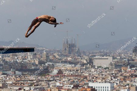 Bo Qiu Bo Qiu from China performs during the men's 10-meter platform semi final at the FINA Swimming World Championships in Barcelona, Spain