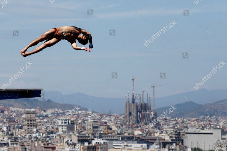 Qiu Bo Gold medalist Qiu Bo from China performs during the men's 10-meter platform final at the FINA Swimming World Championships in Barcelona, Spain