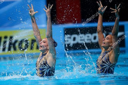 Britain's Olivia Federici and Jenna Randall perform their routine in the synchronized swimming duet final at the FINA Swimming World Championships in Barcelona, Spain