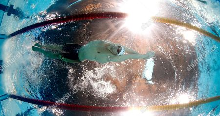 Stock Photo of Ricky Berens swims the anchor leg for the United States in a Men's 4x200m freestyle relay heat at the FINA Swimming World Championships in Barcelona, Spain