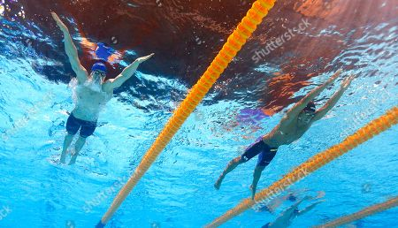 Britain's Roberto Pavoni, left, and Japan's Daiya Seto, right, compete in a Men's 400m individual medley heat at the FINA Swimming World Championships in Barcelona, Spain
