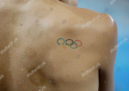 The Olympic rings tattooed onto the back of US swimmer Ricky Berens as he waits to swim during a training session ahead of the FINA Swimming World Championships in Barcelona, Spain
