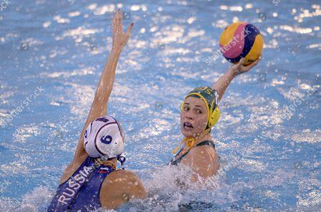 Olga Belova, Nicola Zagame Russia's Olga Belova, left, attempts to block a shot by Australia's Nicola Zagame during a women's water polo semifinal at the FINA Swimming World Championships in Barcelona, Spain