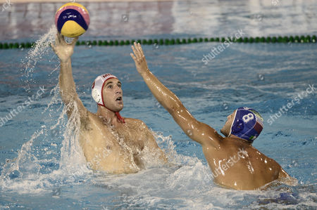 Aleskandar Ivovic, Valentino Gallo Montenegro's Aleskandar Ivovic, left, looks to pass the ball past Italy's Valentino Gallo during their men's water polo semifinal at the FINA Swimming World Championships in Barcelona, Spain