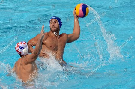 Valentino Gallo, Luka Bukic Italy´s Valentino Gallo, right, vies for the ball against Croatia's Luka Bukic during the men's water polo match for the bronze medal at the FINA Swimming World Championships in Barcelona, Spain
