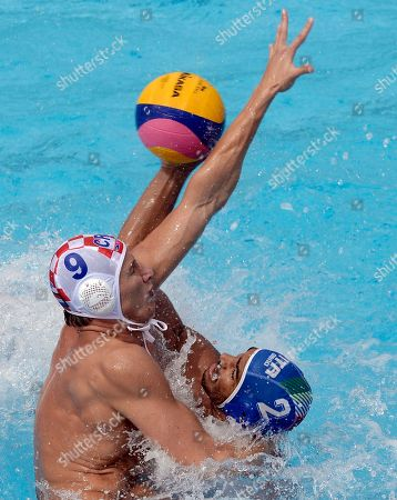 Stock Image of Amaurys Perez, Sandro Sukno Italy´s Amaurys Perez, right, vies for the ball against Croatia's Sandro Sukno during the men's water polo match for the bronze medal at the FINA Swimming World Championships in Barcelona, Spain