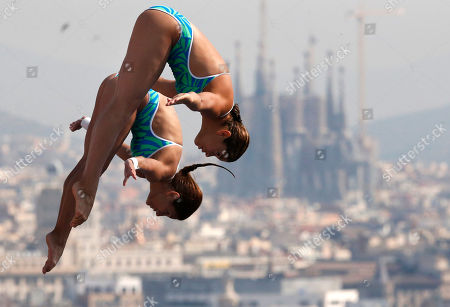 Paola Espinosa and Alejandra Orozco from Mexico perform during the women's 10-meter platform preliminary at the FINA Swimming World Championships in Barcelona, Spain