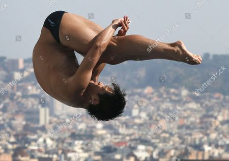 He Cong from China performs during the men's 3-meter springboard preliminary at the FINA Swimming World Championships in Barcelona, Spain
