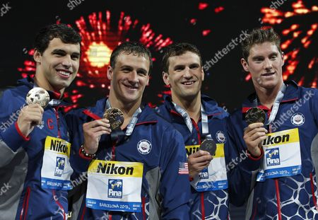 The gold medal winning United States team from left: Ricky Berens, Ryan Lochte, Charles Gipson Houchin and Conor Dwyer smile as they pose for photos after the medal ceremony for the Men's 4x200m freestyle relay final at the FINA Swimming World Championships in Barcelona, Spain