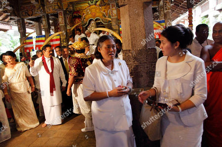 Maha Chakri Sirindhorn, Mahindra Rajapaksa, Shiranthi Rajapaksa Thai Princess Maha Chakri Sirindhorn, foreground second right, visits the Temple of Tooth as Sri Lankan President Mahinda Rajapaksa, second left, accomapnied by his wife, Shiranthi, left, interacts with temple officials in Kandy, Sri Lanka, . Sirindhorn is on a four-day visit on the invitation of the Sri Lankan president