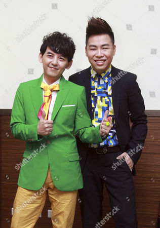 """Hu Yanbin Chinese singer Anson Hu, right, and Taiwanese host Mickey Huang pose for photos during a media event announcing Hu will be the first Chinese appraiser of Taiwanese singing show """"Super Star"""" in Taipei, Taiwan, . The singing show is a popular and subjective of talk between Taiwan and Mainland China"""