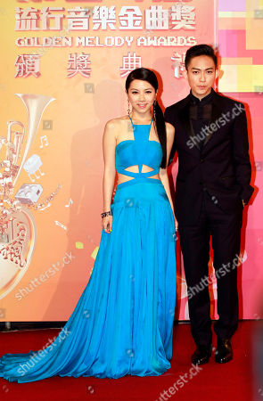 "Gloria Tang, Yoga Lin Chinese singer Gloria Tang, left and Taiwanese singer Yoga Lin arrive at the 24th Golden Melody Awards in Taipei, Taiwan, . They are nominated as Best Female and Male Vocal Performer for their album ""Xposed"" and ""Fiction"" at this year's awards, one of the Chinese-language pop music world's biggest annual events"