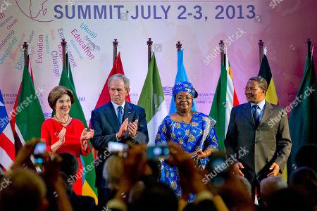 "George W. Bush, Laura Bush, Salma Kikwete, Jakaya Kikwete From left, former U.S. first lady Laura Bush, former U.S. President George W. Bush, Tanzanian first lady Salma Kikwete and Tanzanian President Jakaya Kikwete, arrive at the African First Ladies Summit: ""Investing in Women: Strengthening Africa,"" hosted by the George W. Bush Institute, in Dar es Salaam, Tanzania"