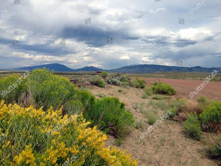 "This photo shows afternoon clouds lazing above Sheep Rock, a bluff overlooking the North Platte River and Bird Cloud Ranch, home of ""Brokeback Mountain"" author Annie Proulx in southeastern Wyoming"