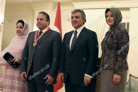 Nawaz Sharif, Abdullah Gul, Kalsoom Nawaz Sharif, Hayrunnisa Gul Pakistan's Prime Minister Nawaz Sharif, second left, Turkish President Abdullah Gul, second right, and their wives Kalsoom Nawaz Sharif, left, and Hayrunnisa Gul pose for cameras during a ceremony to award Sharif with Turkey's Order of The Republic in Ankara, Turkey, . Sharif is in Turkey for a three-day official visit to discuss mutual, bilateral and international issues