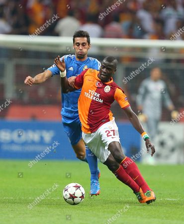 Emmanuel Eboue of Galatasaray, foreground, vies for the ball with Alvaro Arbeloa of Real Madrid, during their Champions League Group B soccer match, in Istanbul, Turkey