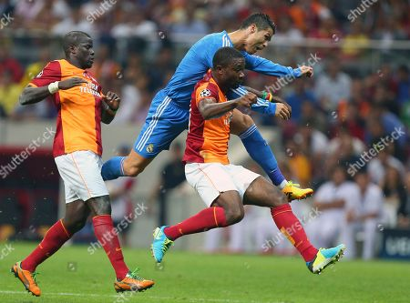 Emmanuel Eboue, Cristiano Ronaldo, Aurelien Chedjou Emmanuel Eboue of Galatasaray, left, watches as Real Madrid's Cristiano Ronaldo, rear centre, vies for the ball with Galatasaray's Aurelien Chedjou, during their Champions League Group B soccer match, in Istanbul, Turkey