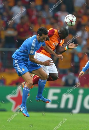 Alvaro Arbeloa, Emmanuel Eboue Emmanuel Eboue of Galatasaray, right, and Real Madrid's Alvaro Arbeloa vies for the ball during their Champions League Group B soccer match in Istanbul, Turkey