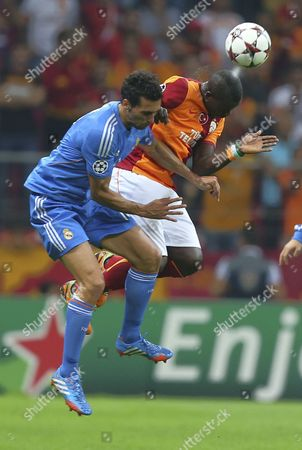 Alvaro Arbeloa, Emmanuel Eboue Emmanuel Eboue of Galatasaray, right, and Real Madrid's Alvaro Arbeloa vies for the ball during their Champions League Group B soccer match in Istanbul, Turkey, . Real won the match 6-1