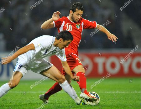 Odil Ahmedov, Musab Al Laham Uzbekistan's Odil Ahmedov, left, and Jordan's Musab Al Laham fight for the ball during their World Cup Asia qualifying soccer match in Tashkent, Uzbekistan