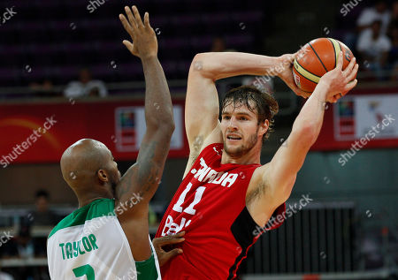 Aaron Doornekamp Canada's Aaron Doornekamp and Brazil's Larry Taylor compete during a FIBA World Cup qualifying basketball game in Caracas, Venezuela, . Canada won 91-62