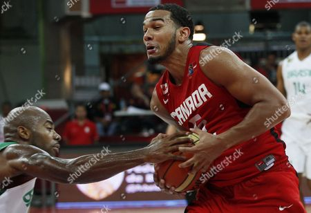 Cory Joseph Canada's Cory Joseph, right, fights for the ball with Brazil's Larry Taylor during a FIBA World Cup qualifying basketball game in Caracas, Venezuela, . Canada won 91-62