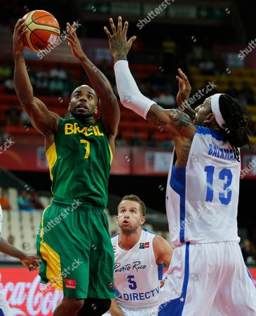 Larry Taylor, Renaldo Balkman, Jose Barea Brazil's Larry Taylor, left, shoots past Puerto Rico's Renaldo Balkman, right, as Jose Barea look on from behind at a FIBA World Cup qualifying basketball game in Caracas, Venezuela