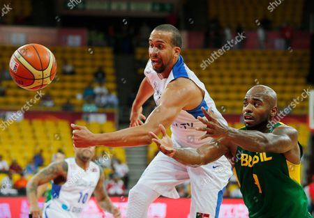 Ricardo Sanchez, Larry Taylor Brazil's Larry Taylor, right, fights for the control of the ball with Puerto Rico's Ricardo Sanchez at a FIBA World Cup qualifying basketball game in Caracas, Venezuela