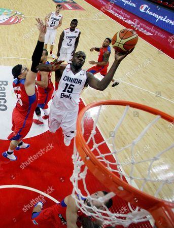 Joel Anthony, Daniel Santiago Canada's Joel Anthony, right, shoots past Puerto Rico's Daniel Santiago during a FIBA World Cup qualifying basketball game in Caracas, Venezuela