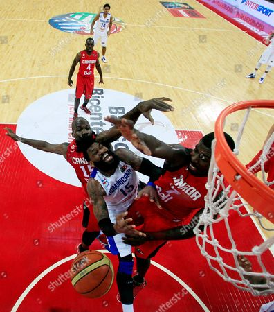Joel Anthony, Andrew Nicholson, Yack Martinez Dominican Republic's Yack Martinez, center, is fouled by Canada's Joel Anthony, left, and Andrew Nicholson at a FIBA World Cup qualifying basketball game in Caracas, Venezuela
