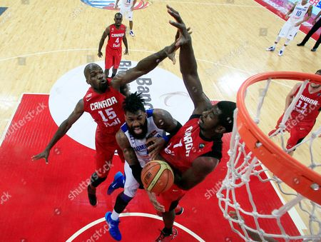 Stock Image of Joel Anthony, Andrew Nicholson, Yack Martinez Dominican Republic's Yack Martinez, center, tries to shoot past Canada's Joel Anthony, left, and Andrew Nicholson at a FIBA World Cup qualifying basketball game in Caracas, Venezuela