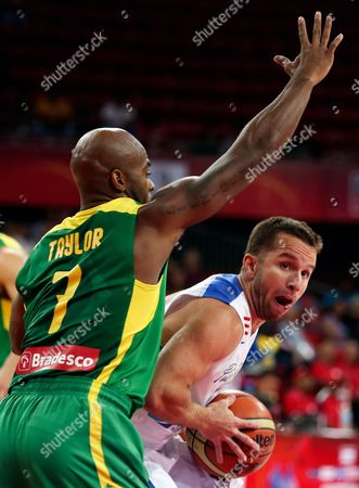 Larry Taylor, Jose Barea Puerto Rico's Jose Barea, right, tries to move past Brazil's Larry Taylor at a FIBA World Cup qualifying basketball game in Caracas, Venezuela