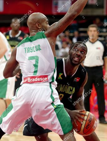 Larry Taylor, Weyinmi Rose Jamaica's Weyinmi Rose, right, tries to move the ball around Brazil's Larry Taylor at a FIBA World Cup qualifying basketball game in Caracas, Venezuela