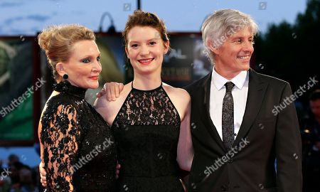 Robyn Davidson, Mia Wasikowska, John Curran Author Robyn Davidson, actress Mia Wasikowska, and director John Curran pose on the red carpet for the film Tracks, during the 70th edition of the Venice Film Festival in Venice
